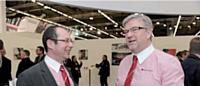 Jean-Michel Jonette et Jean-Claude Toulet, directeur des ventes agricoles, au Salon mondial des fournisseurs de l'agriculture et de l'élevage (Sima).