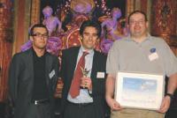 en compagnie de Benoît Ramozzi, de l'Ordre des experts-comptables, Nicolas Lebreton (au centre) et Denis Choteau (à droite), de Video Forever.
