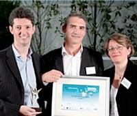 Eric Rousseau (à gauche) et Eric Loesch (à droite) accompagnés d'Isabelle Brouté (Caisse d'épargne)