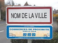 Le label «Commerces dans la ville» est indiqué par des sourires sur fond bleu.