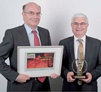 Jean-Jacques Hebras (à droite) a remporté le trophée Association, remis par Eric Lestanguet (GDF Suez Energies France).