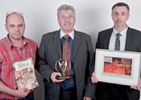 Alain Rochette (au centre) et ses collaborateurs ont reçu le 3e prix.