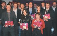 Photo de famille des lauréats et des partenaires.
